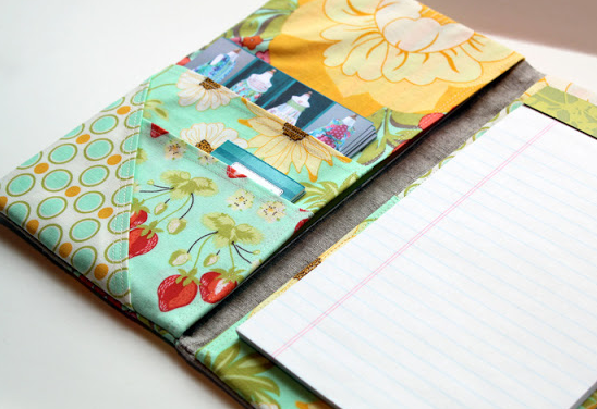 Fabric Portfolio and Notepad holder. SO easy and a great way to add style to your accessories! From The Cottage Mama.