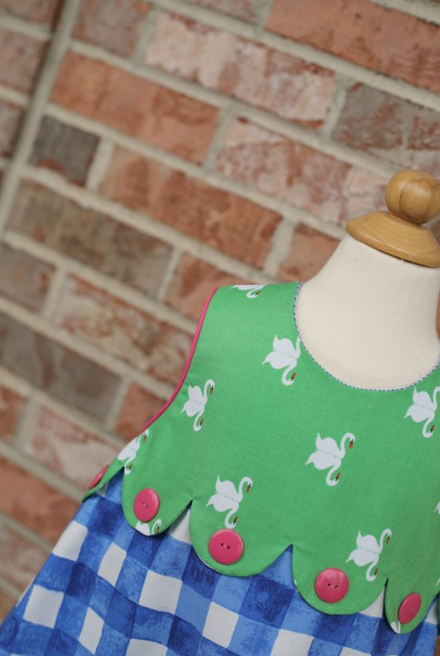 Check out this awesome Janey Jumper Scallop Tutorial from The Cottage Mama!