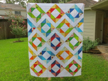 Eat Your Fruits and Veggies Half-Square Triangle Quilt Top