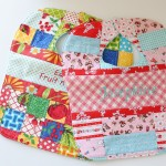 Patchwork Quilted Baby Bib Pattern. www.thecottagemama.com